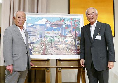 サイコー会40年を記念して神戸の街と石光商事、石光輝男名誉会長(左)らが描かれたイラストを贈呈(右は水垣宏隆サイコー会会長)