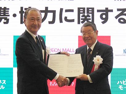 北佳史支社長(左)と因田義男理事長