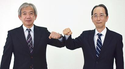 杉本宗一前理事長(左)と中田吉昭新理事長
