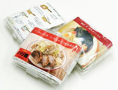 丸山製麺と人気ラーメン店がコラボした冷凍ラーメンと冷凍餃子。価格は原則1食1000円